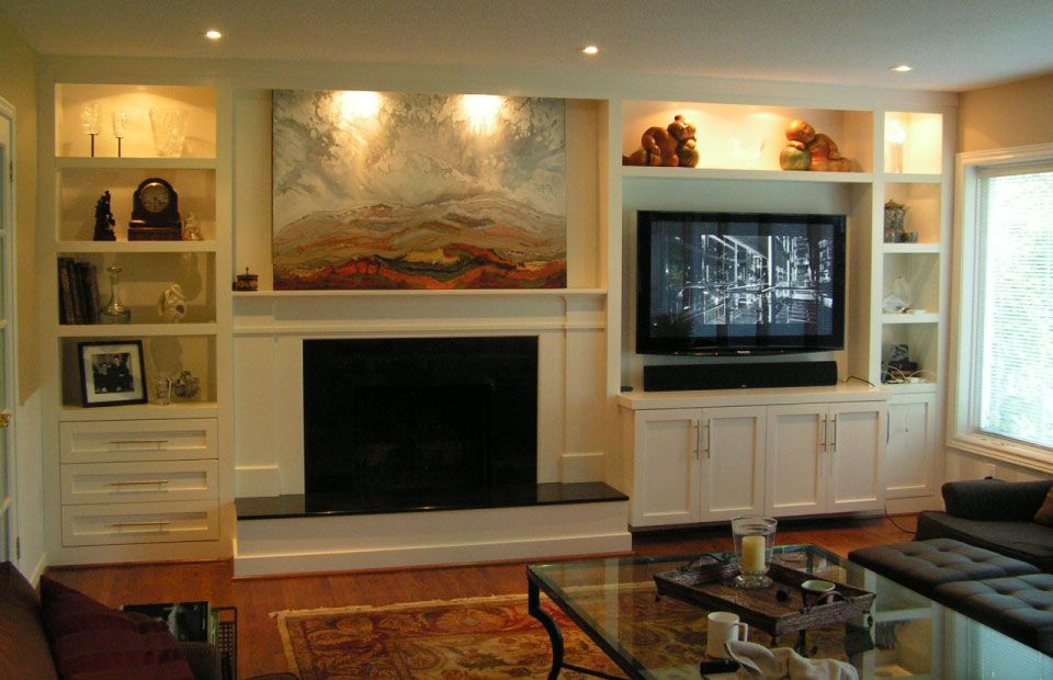 custom cabinetry and fireplace in living room
