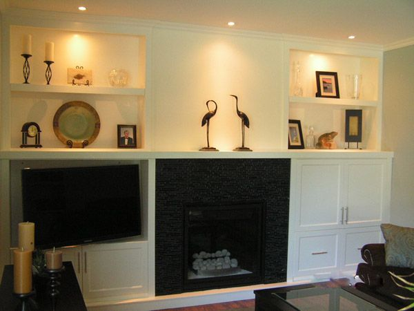 fireplace with white shelves and birds
