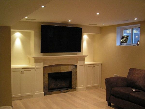 fireplace with white shelves and TV