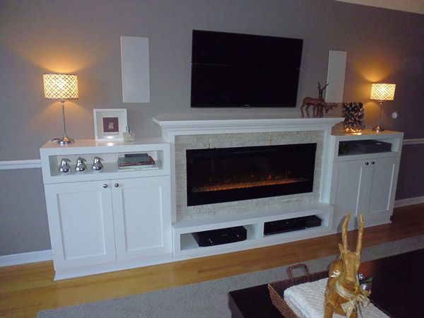 fireplace with entertainment stand and white shelves