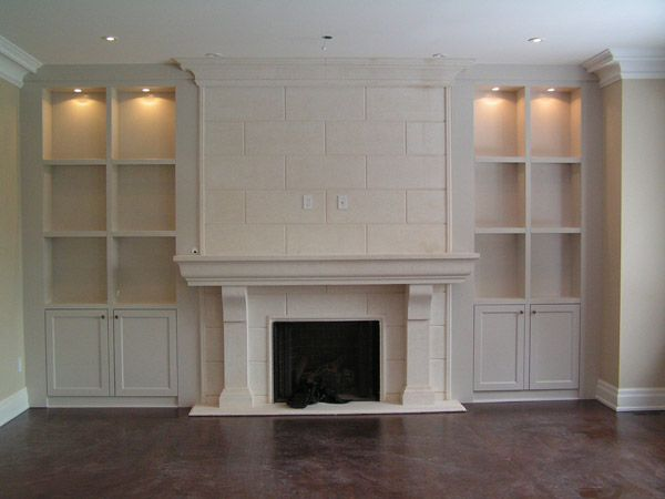 fireplace with white mantel and shelves